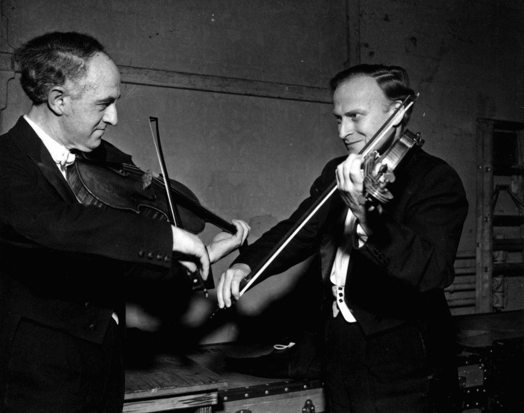 Before a concert. Rudolf Barshai and Yehudi Menuhin.   London, 1962